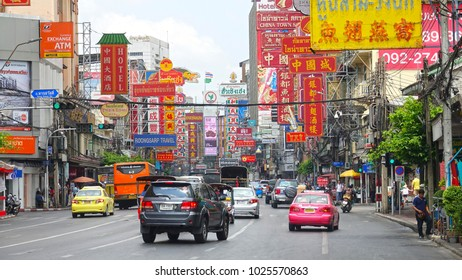 BANGKOK, THAILAND - MARCH 2017: Hectic Yaowarat road filled with dense traffic and numerous signs attracting tourists. Numerous motorbikes and cars filling up roads in famous Chinatown in Bangkok.