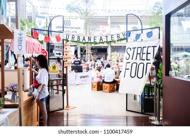 BANGKOK, THAILAND - March 2018 - People and Tourist buying food at street food market festival. Market Stalls. Shopping. Outdoor Market. Food Event. Food Fair. Urban Eatery Concept.