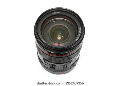 Bangkok, Thailand - March, 2019: Canon EF 24-105mm f/4L IS USM lens isolated on white surface. This lens usually comes with Canon full frame professional DSLR as a kit