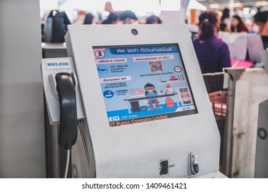 Bangkok, Thailand - March, 2019: modern computer TOT payphone installed at Suvarnabhumi Airport (VTBS) near check in counter, allowing international call.