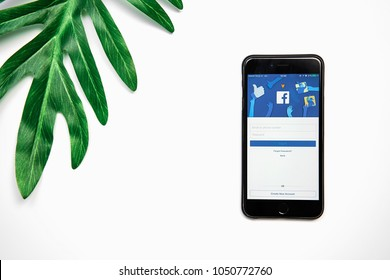 BANGKOK ,THAILAND - March 21, 2018 : Login Screen Facebook icons on Apple iPhone. largest and most popular social networking site in the world.