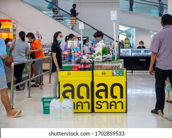 BANGKOK, THAILAND - MARCH 21, 2020: Closeup of customers with face masks in queues at the cashier of a Tesco Lotus supermarket before the COVID-19 emergency decree. Coronavirus and quarantine.
