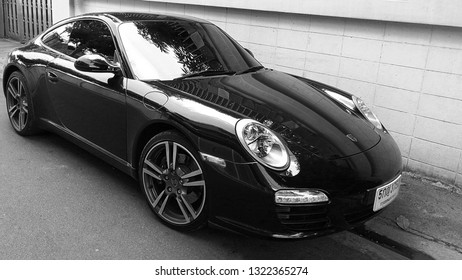 BANGKOK, THAILAND -MARCH 21.2018: Closeup of new luxury car Porsche 911 on the streets of Bangkok
