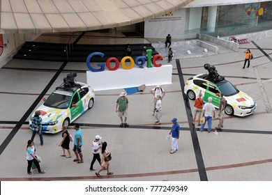 Bangkok, Thailand - March 22, 2012: People view Google Maps Street View cars on a city centre street. The Thai capital has been fully mapped by Google with its Street View service operational.