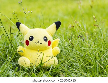 BANGKOK, THAILAND - March 22, 2015: Pokemon center plush doll pikachu. Plush doll pikachu in the garden. Pokemon is famous cartoon in Japan. Pokemon doll is popular collection of Thai teenager.