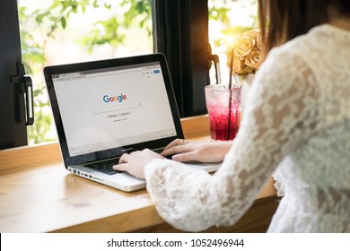 Bangkok. Thailand. March 22, 2017:  A woman is typing on Google search engine from a laptop. Google is the biggest Internet search engine in the world.