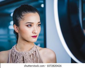 "BANGKOK, THAILAND - MARCH 22, 2018 ; Models Prepares Backstage for Fashion of the South by RMUTSV Srivijaya Fashion Show during ""Bangkok International Fashion Week 2018"" or ""BIFW 2018"" at Siam Center."