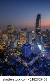 Bangkok, Thailand - March 22, 2018: Scenic view of MahaNakhon and many other lit skyscrapers in downtown Bangkok, Thailand, from above in the evening.