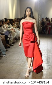 """Bangkok, Thailand - March 22, 2019 ; Model walks in Fashion Show of new collection cloth dress Spring Summer in """"Walk About preview"""", Runway present Brand """"Parrot and Cher'z"""" at ATT 19 Gallery"""