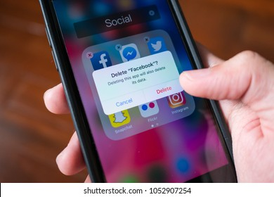 Bangkok, Thailand - March 23, 2018 : Facebook user deleting Facebook application on iPhone 7.