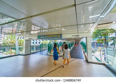 Bangkok, Thailand - March 23, 2019: People walked throught BTS sky walkway at CHIT LOM station in Bangkok, Thailand.