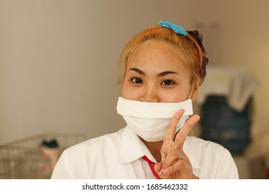 BANGKOK, THAILAND - MARCH 23.2020: COVID-19 Pandemic Coronavirus. Girl with surgical mask on face against Coronavirus Disease 2019.
