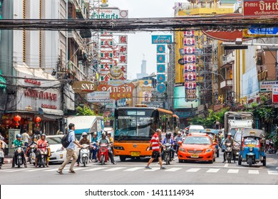 Bangkok, Thailand - March 23rd 2015: People crossing in front of traffic in Chinatown. Traffic is notoriously bad in the city.