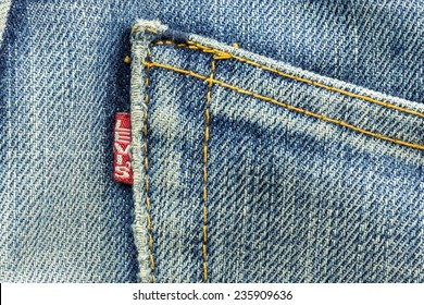 BANGKOK, THAILAND - March 24, 2014: Closeup of Levi's pocket and tag label of logo sewed on a blue jeans. Levi Strauss & Co is a privately held American clothing company.