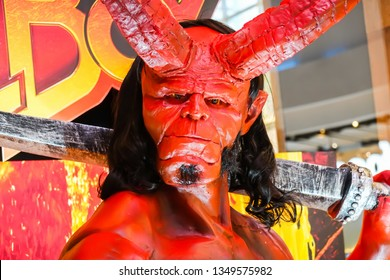 Bangkok, Thailand - March 24, 2019: Hellboy Model With a beautiful standee of a movie called Hellboy display showing at cinema