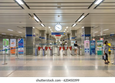 Bangkok, Thailand - March 25, 2017 : MRT subway train station with entrance door and a clock in station MRT runs for passengers in Bangkok. Many people in Bangkok used subway to save time.