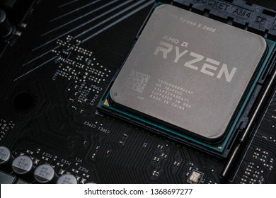 Bangkok, Thailand - March 28, 2019 : Close-up of AMD Ryzen 5 2600 CPU on motherboard. It is a high-performance microprocessor introduced by AMD
