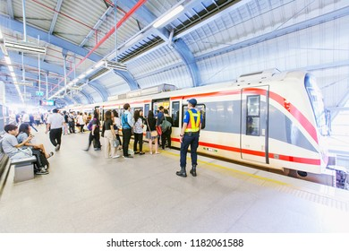 BANGKOK, THAILAND - MARCH 28 : Asian thai people and foreigner passengers walking in journey by MRT at on March 28, 2018 in Bangkok, Thailand