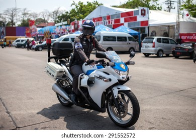 BANGKOK, THAILAND - MARCH 29, 2013 : Unidentified traffic police officer works on a downtown road.