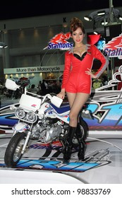 BANGKOK, THAILAND- MARCH 29: Unidentified female presenters with stallions JR11 concept motorcycle  on display at  the Bangkok International Motorshow 2012 on March 29, 2012 in Bangkok,Thailand