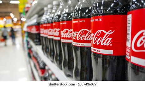 BANGKOK, THAILAND - MARCH 3, 2018: Coca-Cola logo printed on bottle and placed on shopping mall. Coca-Cola is a carbonated soft drink sold in stores and restaurants throughout the world.
