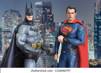 Bangkok, Thailand - March 30, 2016 : Batman and Superman figure on cityscape background. They are superheros from movie franchise who appears in American comic books published by DC Comics.