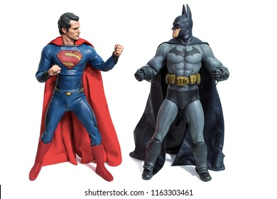 Bangkok, Thailand - March 30, 2016 : Studio shot of Batman and Superman  figurine toys character from movie franchise. They are superheros who appears in American comic books published by DC Comics