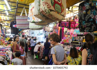 Bangkok, Thailand - March 30, 2018: Shoppers browse the various stores at the Patpong night market. This is a popular tourist attraction in the city.