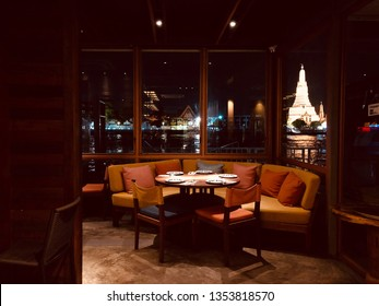 BANGKOK, THAILAND, MARCH 30, 2019: The Thai cuisine restaurant named SUPANNIGA which located by Chao Phraya riverside, has a beautiful scenic view of Arun temple.