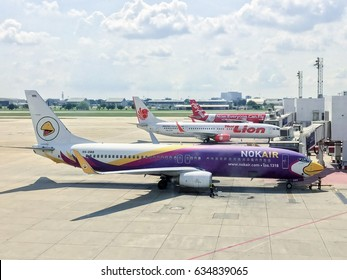 BANGKOK, THAILAND : MARCH 31, 2017:  Thai air asia, Nok air and Thai smile A low cost airline plane parking at Donmuang airport on March 31, 2017 in bangkok thailand