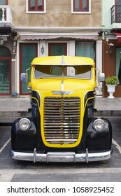 Bangkok, Thailand - March 31, 2018: Front of Antique Dodge Truck. The yellow and black classic retro vintage DODGE Pickup Truck parking at the car park in Venice Di IRIS community mall car park.