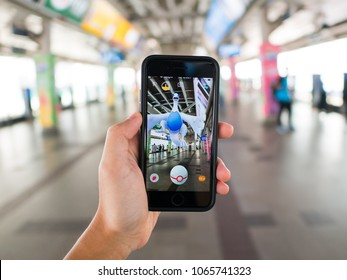 Bangkok, Thailand - March 31, 2018 : Apple iPhone 7 held in one hand showing its screen with Pokemon Go application.