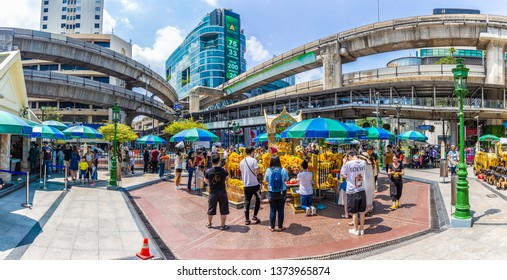 BANGKOK, THAILAND - March 31 2019: Erawan Shrine Tourists and local people make a merit at Erawan Shrine on New Year day at Ratchaprasong Junction, Grand Hyatt Erawan Hotel.