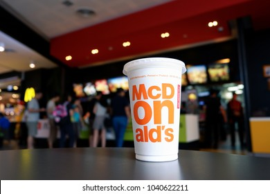 Bangkok, Thailand - March 4, 2018 : Cup of McDonald's Cola in the background of the McDonald's restaurant. McDonald's Corporation is the world's largest fast food restaurants.