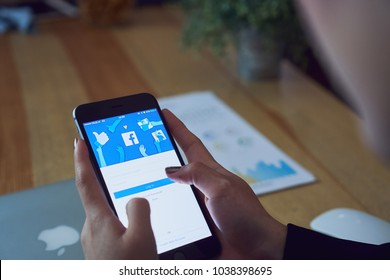 Bangkok, Thailand - March 5, 2018 : hand is pressing the Facebook screen on apple iphone6 ,Social media are using for information sharing and networking.