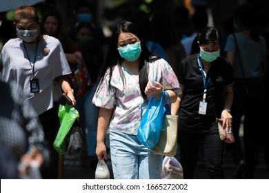 BANGKOK, THAILAND - MARCH 6, 2020: Citizens in Bangkok wearing masks as a protective measure against coronavirus in Bangkok, Thailand.