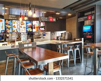 Bangkok, Thailand - March 7,2019 : KFC drive thru on Ramintra Rd., Opposite Synphaet Hospital. KFC is a fast food restaurant chain that specializes in fried chicken