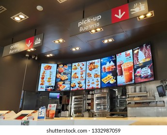 Bangkok, Thailand - March 7,2019: KFC drive thru on Ramintra Rd., Opposite Synphaet Hospital. KFC is a fast food restaurant chain that specializes in fried chicken