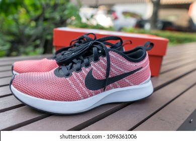 Bangkok, Thailand - March 8, 2018: The NIKE pink shoes of women for exercise at the park.