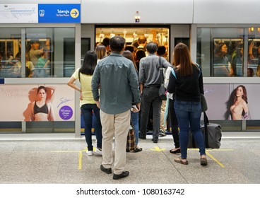 Bangkok Thailand - March 9, 2018: The The passengers walking to the inside MRT subway train arrived in the rush hour, Transportation of the Bangkok Mass Rapid Transit