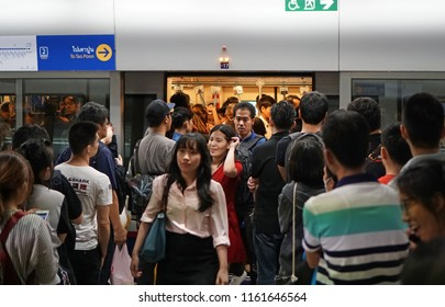 Bangkok Thailand - March 9, 2018: The passengers entering MRT subway train arrived and people line up for waiting to enter inside, Rush hour, Transportation of the Bangkok Mass Rapid Transit