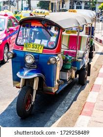 BANGKOK, THAILAND - March 9th, 2020: Tuk Tuk in bangkok. Tuk Tuk is a common form of urban transport in Chinatown at Bangkok, Thailand.