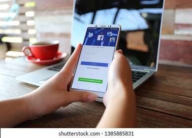 Bangkok, Thailand : May 01, 2019, Woman hand using Vivo V7 with Facebook social media app and Create new facebook account or log in, typing message or checking newsfeed on social networks