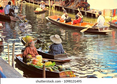 BANGKOK, THAILAND - May 08, 2018: unidentified tourists and traditional vendors on the famous floating market Damnoen Saduak in Bangkok. It is a traditional market on the khlongs