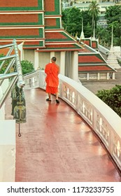 BANGKOK, THAILAND -  May 08, 2018: monk climbing down the stairs of the Golden Mount, Wat Saket temple, Bangkok with Bangkok city view in the background