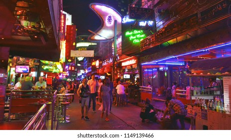 Bangkok, Thailand - May 1, 2017: Soi Cowboy is one of the red light district areas of Bangkok. By night, adult tourists wander there and are accosted by young Thai women in sexy outfits.