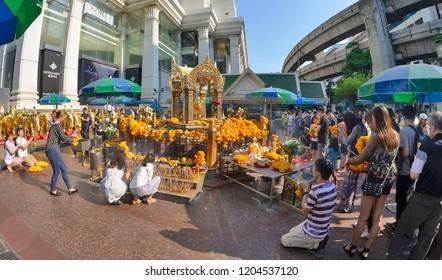 Bangkok, Thailand - May 1, 2017: Thai Buddhists worshipping the four-faced Brahma statue at Erawan Shrine.