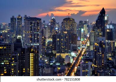Bangkok, Thailand - May 1, 2017. Sunset on Sukhumvit buildings from a rooftop bar.