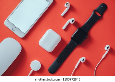 Bangkok, Thailand - May 1, 2018: Apple Gadgets and devices on red background.