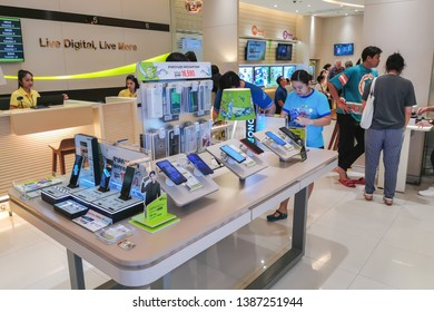 Bangkok, Thailand - May 1, 2019 : Showcase with smartphones in the modern electronics store. Buy a mobile phone. Many smartphones on the shelf of the technology store  at AIS service mobile.
